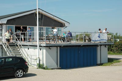 The Langstone Sailing Club Terrace with the bar behind the patio doors
