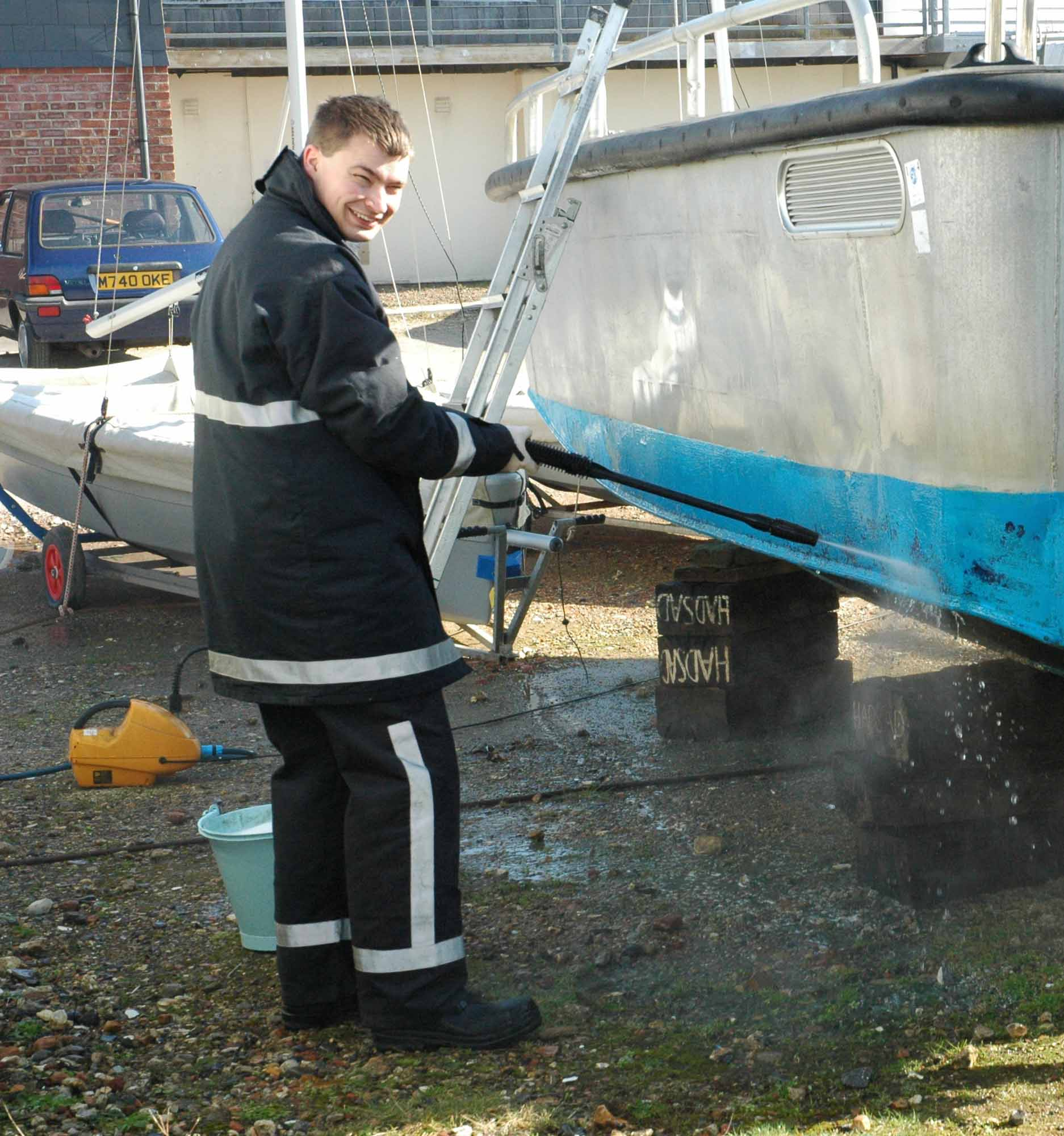 Luke cleaning the hull of Hilary Farrow